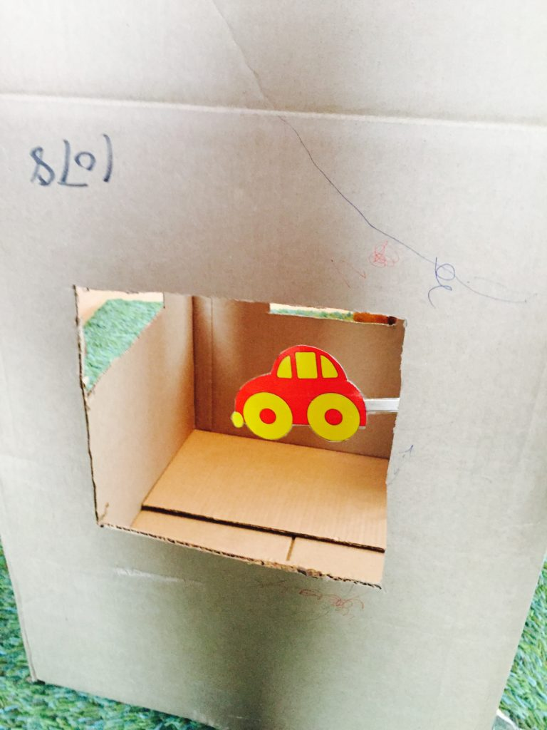 Cardboard house 6 play ideas, activities for one year old, development promoting activities for toddlers, toddler games, activities for 12 month old, activities for 13 month old, activities for 14 month old, activities for 15 month old, activities for 16 month old, activities for 17 month old, activities for 18 month old, games for toddler, activities for a toddler, activities for one year olds, activities for two year olds