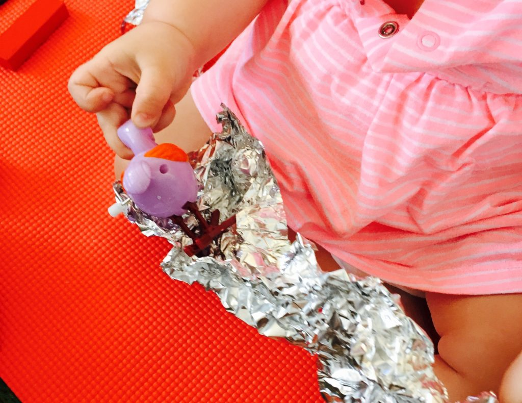 Wednesday box of activities, opening foil wrapped toys, activities for one year old, activities for toddlers, toddler games, activities for 12 month old, activities for 13 month old, activities for 14 month old, activities for 15 month old, activities for 16 month old, activities for 17 month old, activities for 18 month old, activities for 19 month old, activities for 20 month old