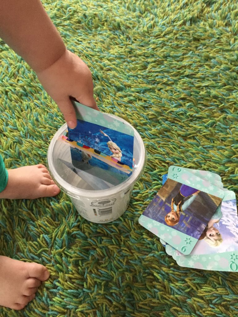 Wednesday box of activities. Inserting cards into a container. Activities for 15 month olds, activities for 16 month olds, activities for 17 month olds, activities for 18 month olds, activities for toddlers, activities for 19 month olds, activities for 20 month olds