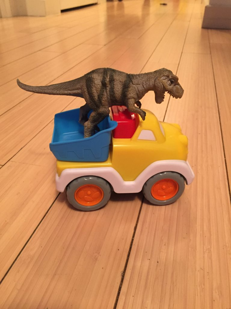 Sending dino for a ride, Saturday box of activities, activities for one year old, activities for toddlers, activities for 12 month old, activities for 13 month old, activities for 14 month old, activities for 15 month old, activities for 16 month old, activities for 17 month old, activities for 18 month old