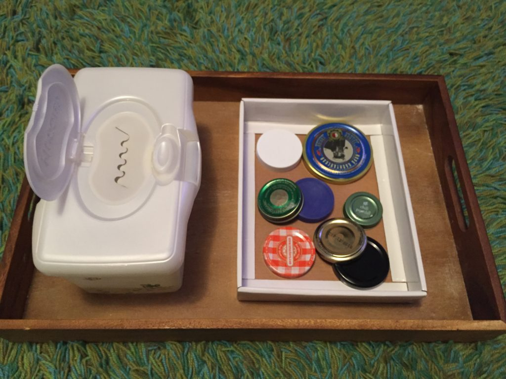 Sorter with lids and a wipes box, Tuesday box of activities, play ideas for toddlers, activities for one year old, montessori activities for a toddler, development promoting activities for toddlers, activities for 13 month old, activities for 14 month old, activities for 15 month old, activities for 16 month old, activities for 17 month old, activities for 18 month old, activities for a toddler, activities for one year olds, activities for two year olds