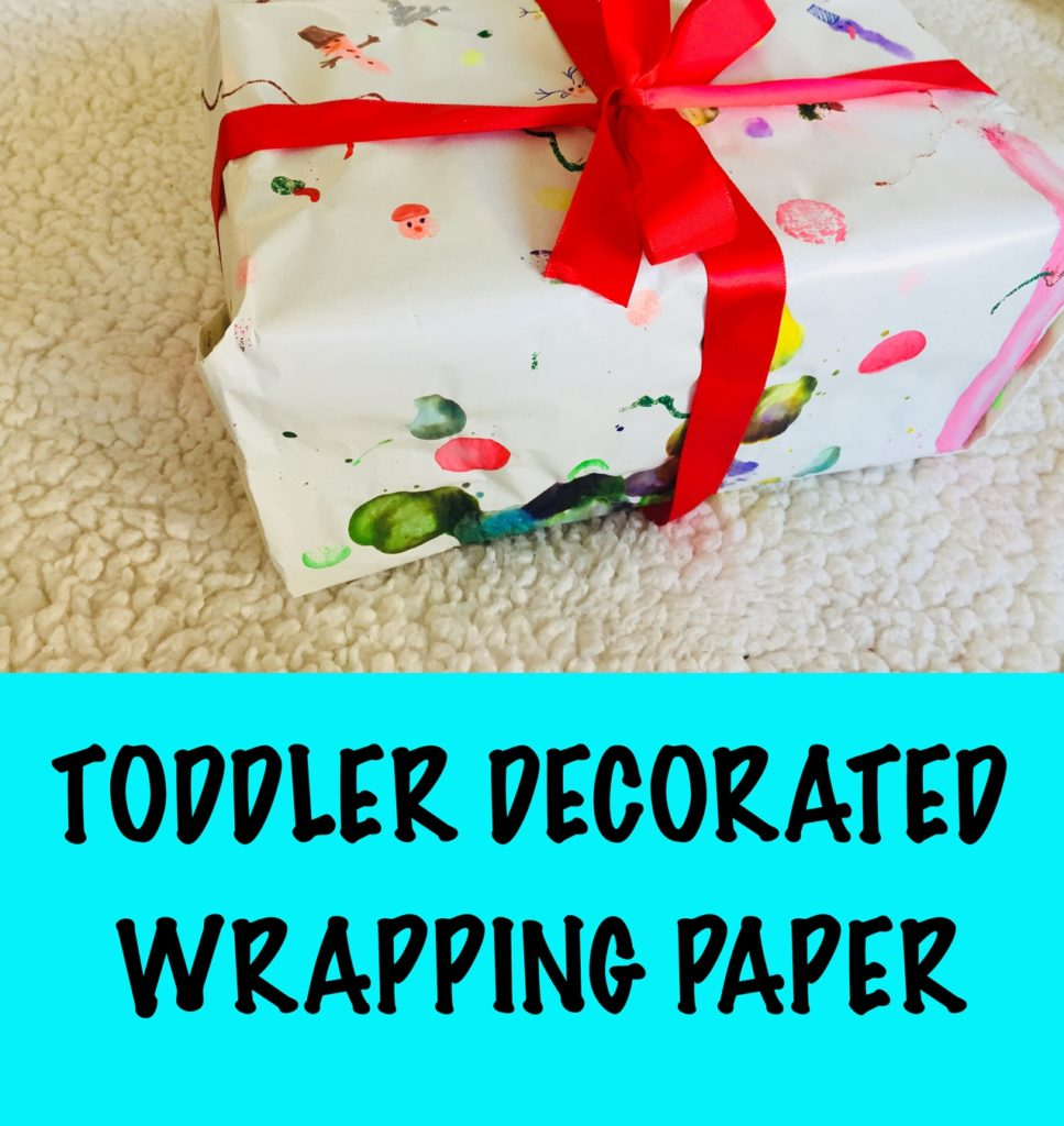 Toddler decorated wrapping paper, toddler made wrapping paper, wrapping paper craft for toddlers, 24 christmas activities, winter activities, 24 christmas activities for toddlers, winter activities for toddlers, advent calendar activities, christmas activities for 2 year olds, christmas activities for 3 year olds, toddler crafts, toddler christmas crafts, christmas crafts for toddlers, christmas crafts for two year olds, christmas crafts for three year olds