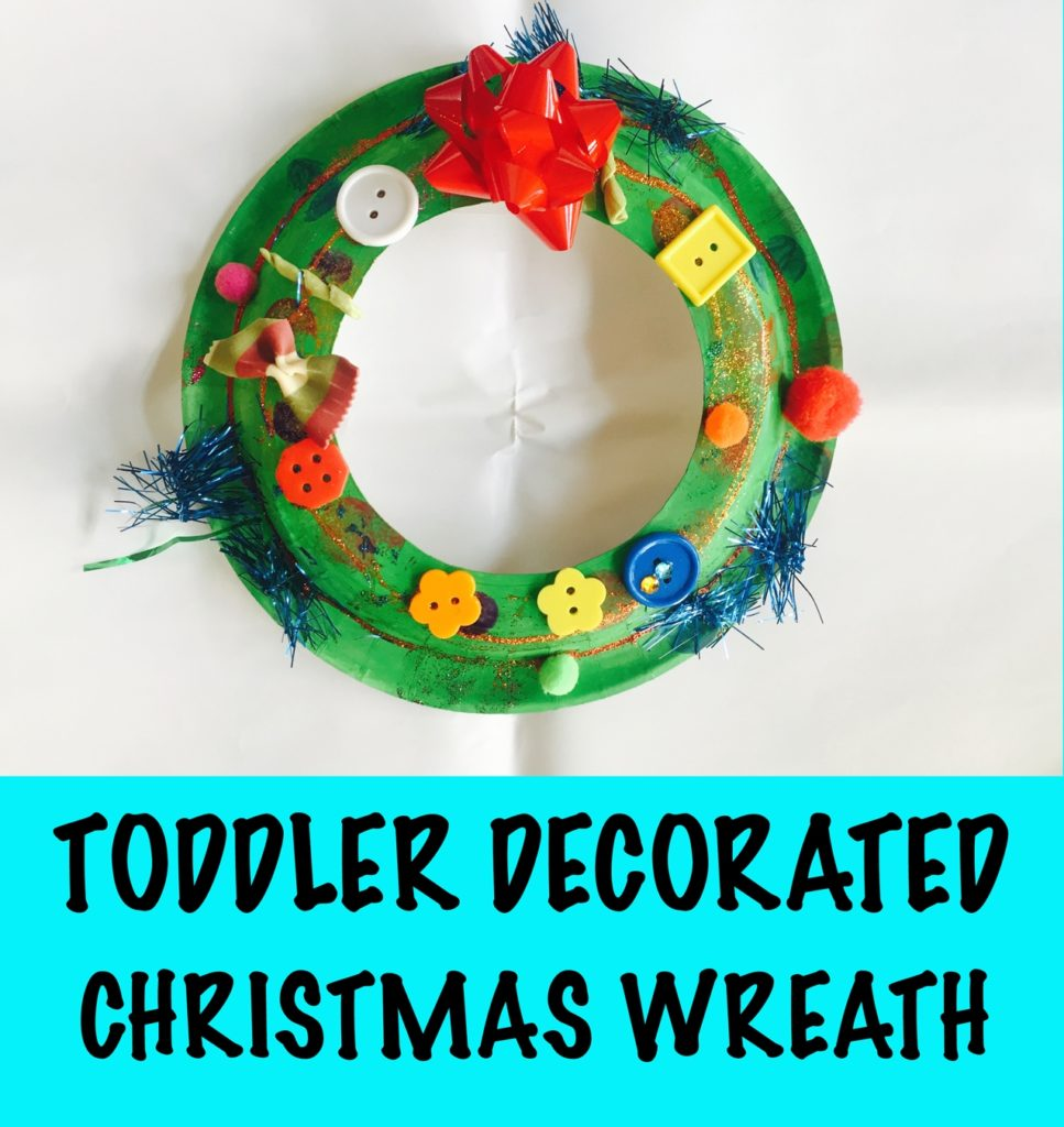 Paper plate christmas wreath, toddler decorated christmas wreath, 24 christmas activities, winter activities, 24 christmas activities for toddlers, winter activities for toddlers, advent calendar activities, christmas activities for 2 year olds, christmas activities for 3 year olds, toddler crafts, toddler christmas crafts, christmas crafts for toddlers, christmas crafts for two year olds, christmas crafts for three year olds